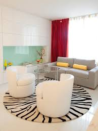 modern living room with zebra round area rug and modern furniture