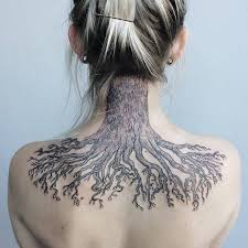 nature artist creates large scale tattoos withfantastical spin