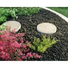 lava pebbles use as mulch in landscaping looks so nice and won