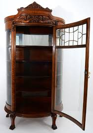 oak china cabinet with leaded glass door and curved side display