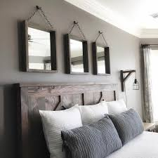 love this master bedroom shanty s tutorials pinterest love this master bedroom rustic headboard with hanging mirror accents neatly arranged pillows on a large bed