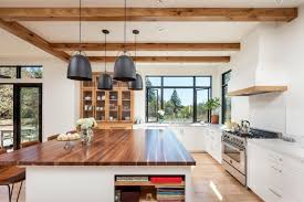 kitchen kitchen island with wood countertops and pendant lighting
