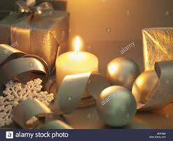 christmas gifts ornaments and candle stock photo royalty free