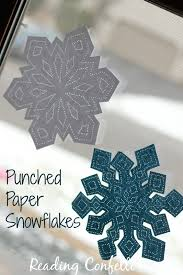 winter craft punched paper window snowflakes reading confetti