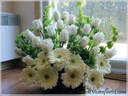 funeral arrangement white and green funeral arrangement with roses gerberas and