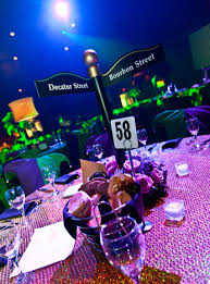 new orleans party supplies in the party space four different centerpieces topped tables