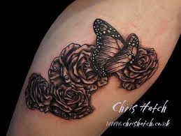 butterfly on flowers tattoo design tattoos book 65 000 tattoos