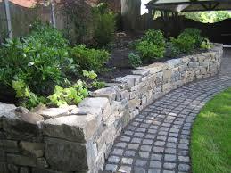 dressed dry stone raised planting bed and granite cobbled sett