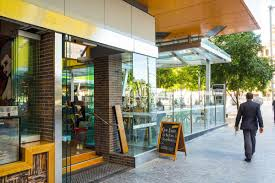 frameless glass stacking doors brisbane square project with patterned roof glass u2013 euroglass