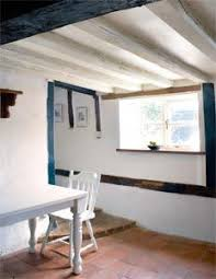 brighten up your space by repainting ceiling beams a lighter