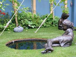 home backyard garden design ideas with bronze garden statues and