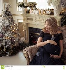beautiful pregnant woman in a holiday dress stock photo image