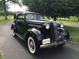 1936 pontiac silver streak 2 door sedan with a beautiful indian