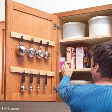 clever kitchen cabinet pantry storage ideas family handyman measuring cup hang up