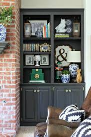 urbane bronze living room shelves oak shelves dimples and tangled