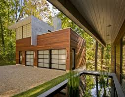 modern house design in a perfect forest landscape by robert gurney