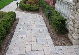 outdoor and patio brick walkways designs for homes combined with stone walkway designs for homes with green lush plants and green grass yard also two