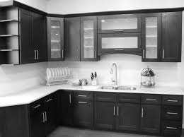 black wooden kitchen storage cabinets with glass doors and white