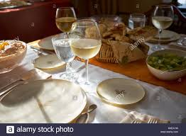 table set for a formal thanksgiving dinner with empty plates stock