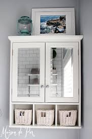 bathroom large over the toilet cabinet white finish how bathroom white over the toilet cabinet with mirrored doors featuring wicker storage units