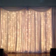 pipe and drape with twinkle light curtains beautiful