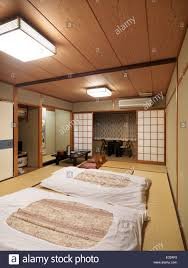 Traditional Japanese Bedroom - traditional japanese room at a ryokan with futons on the floor and