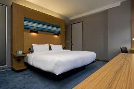 sleek dark grey wooden queen floating bed frame with yellow