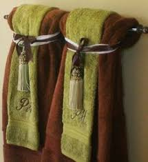 bathroom towel folding ideas 18 effective ways to organize your bathroom towels house and bath