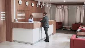 Free Reception Desk with Pan Shot Of Business Hotel Lobby Guest At The Reception Desk