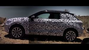 vw takes new t roc crossover off road on a walking path