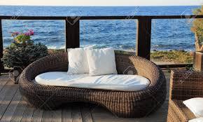 Modern Wicker Patio Furniture by A Modern Wicker Garden Sofa In The Terrace With Sea View Stock