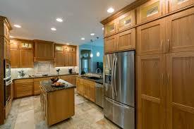 Stone Tile Kitchen Floors - contemporary kitchen with flat panel cabinets u0026 custom hood