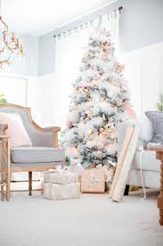 white tree with pink and gold decorations chagne