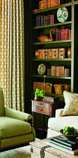 Green Bookshelves - i love the green of the bookshelves and the couch being right in