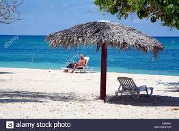 Beach Sun Umbrella Man Relaxing Near A Sun Umbrella On A Beach Guardalavaca Holguin