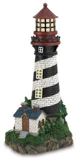 solar powered lighthouse style garden statues and yard
