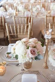soft blush pink and gold wedding flowers and decor wedding table