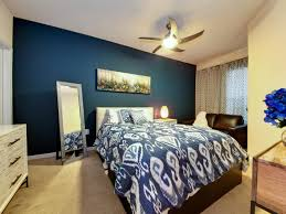 Accent Colors For Tan Walls by A Striking Peacock Blue Accent Wall And Bold Ikat Bedding Form A