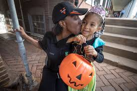 trick or treating on the lawn delivers a happy community halloween