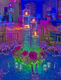 funky neon lighting with floating candle centerpieces at a bat