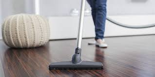 cleaning hardwood floors with an electric broom