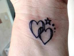 two black small linked love hearts with stars tattoo heart tattoos