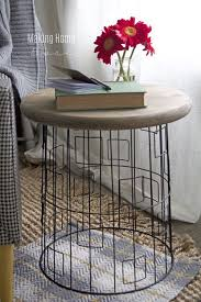 wire and wood basket side table diy accent table from a wire laundry basket craft