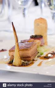 restaurant nouvelle cuisine nouvelle cuisine pork dish in a michelin restaurant stock photo