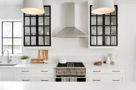 white kitchen cabinet with glass doors white cabinets with black frame glass doors transitional