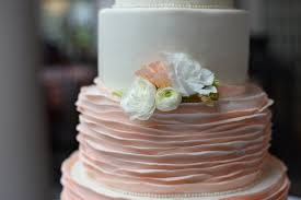 peach ombre wedding cake ombré peach smooth ruffle four tier wedding cake with sugar and real