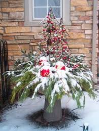 the client s artificial trees set inside concrete urns then