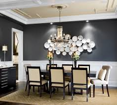 dark wainscoting dining room transitional with black molding beige