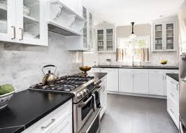 white cabinets with black countertops and backsplash which countertops are most expensive hgtv