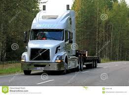 volvo semi price white volvo vnl 64t semi trailer on highway editorial stock photo
